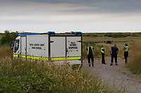 Pictured: A Royal Logistics Corps, Bomb Disposal Unit at the scene.<br /> Re: A Bomb Disposal Unit was called after a bomb was discovered at a scrap yard in Skewen near Neath, and then transported to Crymlyn Burrows beach for a controlled explosion in south Wales, UK.