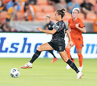 HOUSTON, TX - SEPTEMBER 10: Mallory Pugh #9 of the Chicago Red Stars brings the ball up the field during a game between Chicago Red Stars and Houston Dash at BBVA Stadium on September 10, 2021 in Houston, Texas.
