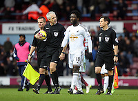 Sunday 07 December 2014<br /> Pictured: Match referee Chris Foy and Wilfried Bony walking off the pitch at half time <br /> Re: Premier League West Ham United v Swansea City FC at Boleyn Ground, London, UK.