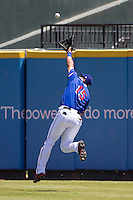 Round Rock Express outfielder Guilder Rodriguez #15 attempts to make a running catch during the Pacific Coast League baseball game against the New Orleans Zephyrs on May 5, 2014 at the Dell Diamond in Round Rock, Texas. The Zephyrs defeated the Express 13-4. (Andrew Woolley/Four Seam Images)