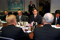 Feb. 16, 2001, Washington, DC, United States<br /> <br /> Japanese Senior Vice Minister of Foreign Affairs Seishiro Eto (right) and Ambassador to the U.S. Shunji Yanai (left) meet in the Pentagon with Deputy Secretary of Defense Rudy de Leon (left foreground) on Feb. 16, 2001, to discuss the February 9th collision of the submarine USS Greeneville and the Japanese fishing vessel Ehime Maru.  <br /> .<br /> <br /> Mandatory Credit: Photo by DoD photo by R. D. Ward. (Released)