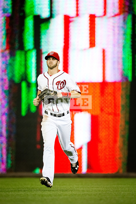Washington Nationals outfielder Bryce Harper (34) runs in from the outfield during a game against the Miami Marlins at Nationals Park in Washington, DC on September 7, 2012.