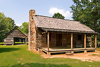 Main dwelling, corn crib, and barn on a typical Cherokee farm, at New Echota, Georgia.