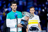 21st February 2021, Melbourne, Victoria, Australia; Novak Djokovic of Serbia holds his trophy as he makes his speech after winning the Men's Singles Final of the 2021 Australian Open on February 21 2021, at Melbourne Park in Melbourne, Australia.