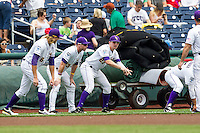 LSU Tigers Andrew Stevenson (6), Jared Foster (17) and Danny Zardon (27) warm up before the NCAA College World Series game against the TCU Horned Frogs on June 14, 2015 at TD Ameritrade Park in Omaha, Nebraska. TCU defeated LSU 10-3. (Andrew Woolley/Four Seam Images)
