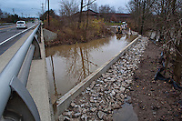 Construction equipment sits  in flood waters along a bike path under Schrock Road in Westerville. The equipment is used by the crew building a flood  retaining wall to keep flood waters from Alum Creek overflowing its banks and covering the bike path. The wall has yet to be completed.