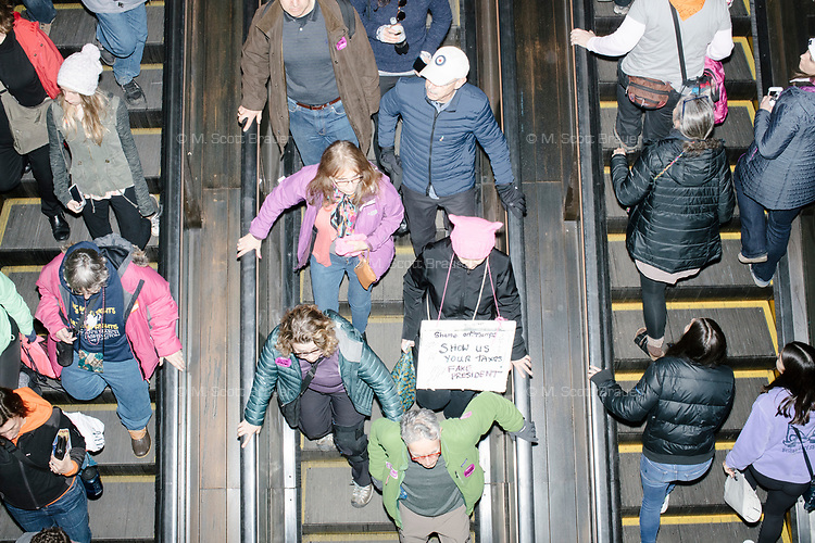 People ride a DC metro subway station escalator after people gathered in the National Mall area of Washington, DC, for the Women's March on Washington protest and demonstration in opposition to newly inaugurated President Donald Trump on Jan. 21, 2017.