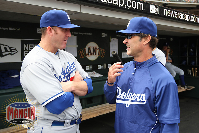 SAN FRANCISCO - SEPTEMBER 13:  Jim Thome and hitting coach Don Mattingly of the Los Angeles Dodgers get ready in the dugout before the game against the San Francisco Giants at AT&T Park on September 13, 2009 in San Francisco, California. Photo by Brad Mangin