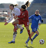 US forward Abby Wambach (17) collides with Italian goalkeeper anna Maria Picarelli (1).  The U.S. Women's National Team defeated Italy 1-0 at Toyota Park in Bridgeview, IL on November 27, 2010 to advance to the Women's World Cup in Germany.