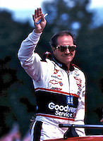 NASCAR driver Dale Earnhardt acknowledges cheers from race fans before the start of the Frontier at the Glen Winston Cup race in Watkins Glen, New York 8/15/99(Photo by Brian Cleary)  Frontier at the Glen, Watkins Glen International Raceway, Watkins Glen, NY, August 15, 1999.  (Photo by Brian Cleary/www.bcpix.com)