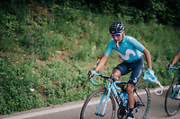 Nairo Quintana (COL/Movistar) trying to get rid of his musette after the feedzone<br /> <br /> Stage 4: Gansingen > Gstaad (189km)<br /> 82nd Tour de Suisse 2018 (2.UWT)