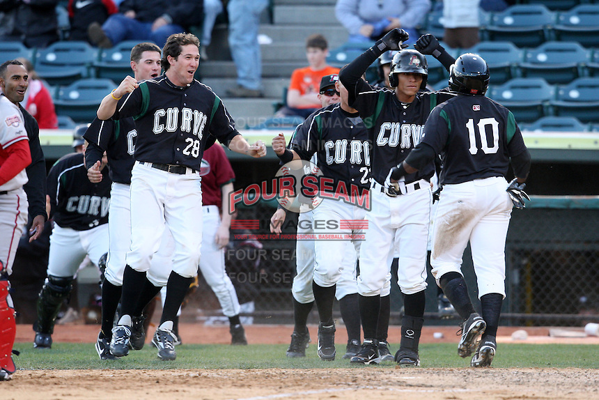 April 10, 2010:  Miles Durham (28), Jordy Mercer (14), Hector Gimenez (23), Gorkys Hernandez of the Altoona Curve celebrate as Josh Harrison scores the winning run in the 10th inning during a game at Blair County Ballpark in Altoona, PA.  Photo By Mike Janes/Four Seam Images