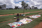 Poverty Brasilia Brazil family selling clothes South America. New modern city in background. 1985