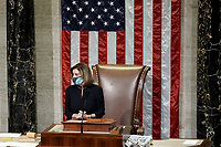 Speaker of the United States House of Representatives Nancy Pelosi (Democrat of California) announces the vote count for H.R. 24, an article of impeachment against President Donald Trump, on Wednesday, January 13, 2021 in the House Chamber at the U.S. Capitol.<br /> Credit: Greg Nash / Pool via CNP /MediaPunch
