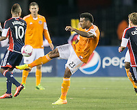 Houston Dynamo midfielder Giles Barnes (23) clears the ball.  The New England Revolution played to a 1-1 draw against the Houston Dynamo during a Major League Soccer (MLS) match at Gillette Stadium in Foxborough, MA on September 28, 2013.