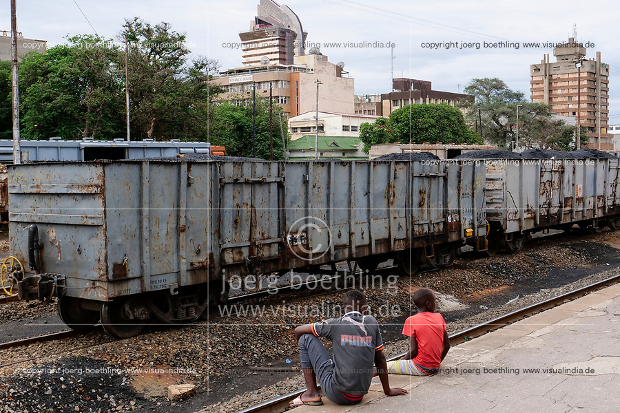 ZAMBIA, capital Lusaka, downtown, Railway station with freight wagon loaded with hard coal, behin building in Cairo Road