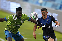 SAN JOSE, CA - OCTOBER 18: Yeimar Gomez Andrade #28 of the Seattle Sounders battles for the ball with Cristian Espinoza #10 of the San Jose Earthquakes during a game between Seattle Sounders FC and San Jose Earthquakes at Earthquakes Stadium on October 18, 2020 in San Jose, California.