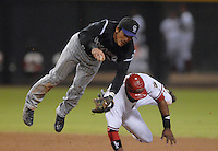 Oct 11, 2007; Phoenix, AZ, USA; Arizona Diamondbacks right fielder (10) Justin Upton takes out Colorado Rockies second baseman (7) Kazuo Matsui on a double play attempt in the seventh inning during game 1 of the 2007 National League Championship Series at Chase Field. Upton was ruled out for player interference. Mandatory Credit: Mark J. Rebilas-US PRESSWIRE