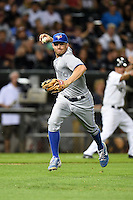 Toronto Blue Jays third baseman Danny Valencia (15) throws to first on the run during a game against the Chicago White Sox on August 15, 2014 at U.S. Cellular Field in Chicago, Illinois.  Chicago defeated Toronto 11-5.  (Mike Janes/Four Seam Images)