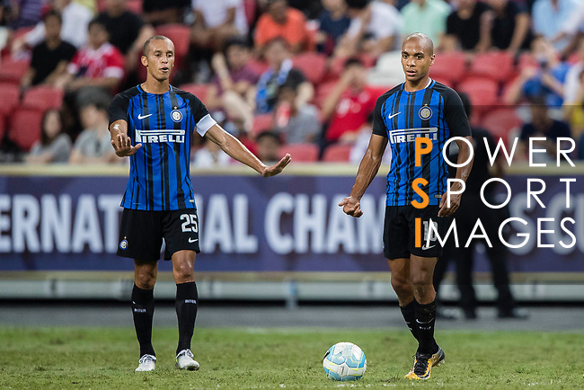 FC Internazionale Defender Joao Miranda (L) and FC Internazionale Midfielder Joao Mario (R) in action during the International Champions Cup match between FC Bayern and FC Internazionale at National Stadium on July 27, 2017 in Singapore. Photo by Marcio Rodrigo Machado / Power Sport Images