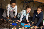 Education elementary school Grade 4 students working on a collaborative social studies project
