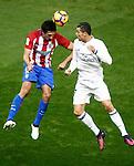 Atletico de Madrid's Stefan Savic (l) and Real Madrid's Cristiano Ronaldo during La Liga match. November 19,2016. (ALTERPHOTOS/Acero)