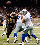 December 2009: Dallas Cowboys quarterback Tony Romo (9) passes the ball as New Orleans Saints linebacker Jonathan Vilma (51) applies pressure during an NFL football game at the Louisiana Superdome in New Orleans.  The Cowboys defeated the Saints 24-17.