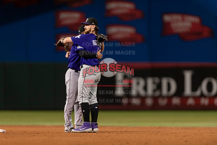 Albuquerque Isotopes Elliot Soto (3) and Brendan Rodgers (1) celebrate a win after a game against the El Paso Chihuahuas at Southwest University Park on May 10, 2019 in El Paso, Texas. Albuquerque defeated El Paso 2-1. (Zachary Lucy/Four Seam Images)