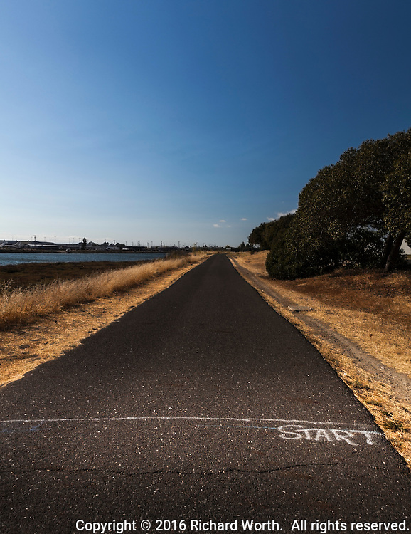 START in chalk on a paved path at Martin Luther King Jr. Regional Shoreline in Oakland, California