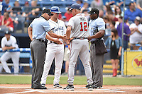 First base umpire Justin Robinson Asheville Tourists manager Warren Schaeffer, (13) Rome Braves manager Randy Ingle, (12) and homeplate umpire Chris Lloyd before a game between the Rome Braves and Asheville Tourists on May 17, 2015 in Asheville, North Carolina. The Tourists defeated the Braves 9-8. (Tony Farlow/Four Seam Images)
