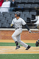 Jaylin Davis (21) of the Appalachian State Mountaineers follows through on his swing against the Wake Forest Demon Deacons at Wake Forest Baseball Park on February 13, 2015 in Winston-Salem, North Carolina.  The Mountaineers defeated the Demon Deacons 10-1.  (Brian Westerholt/Four Seam Images)