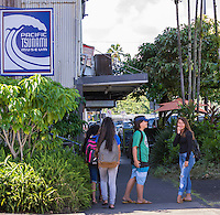 Local teenagers hang out near the Pacific Tsunami Museum in downtown Hilo, Big Island of Hawai'i.