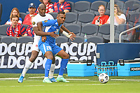 KANSASCITY, KS - JULY 11: Stephane Abaul #20 of Martinique held by Kamal Miller #4 of Canada during a game between Canada and Martinique at Children's Mercy Park on July 11, 2021 in KansasCity, Kansas.