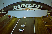 12.06.1988. Le Mans 24 Hours. The winning Tom Walkinshaw Racing Jaguar XJR-9LM driven by Jan Lammers, Johnny Dumfries and Andy Wallace under the iconic Dunlop bridge. Dumfries, real name John Colum Crichton-Stuart, 7th Marquis of Bute, passed away on 22nd March 2021 after a brief illness