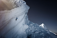 Doug Tavener climbing an overhanging serac on the Mt Blanc du Tacul, Chamonix
