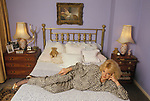 Mandy Rice Davies portrait in her bedroom London home 1990s UK