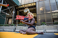 """NEW YORK, NY - JULY 9: A woman performs next to the """"Black Lives Matter"""" mural in front of the Trump Tower in New York, NY on July 9, 2020. Bill de Blasio, Mayor of New York and founders from National Action Network Inc. (NAN) paints a """"Black Lives Matter"""" mural along Fifth Avenue across from the Trump Tower in New York. President Donald Trump criticized the mayor's plan to paint a street mural in front of Trump Tower. (Photo by Pablo Monsalve / VIEWpress via Getty Images)"""