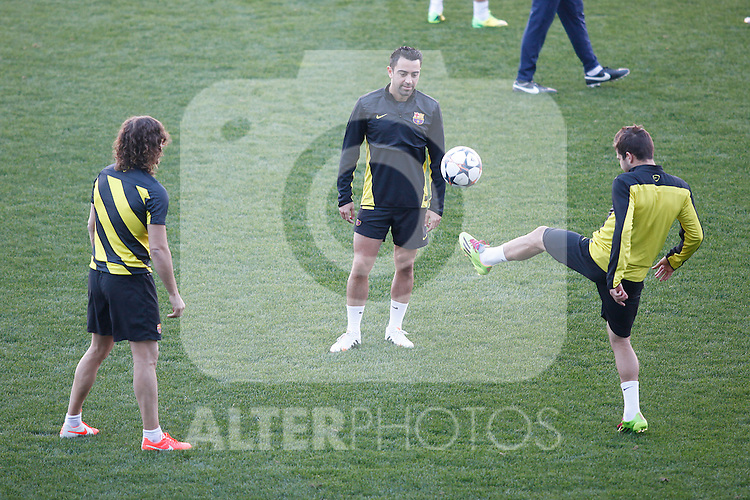 FC Barcelona´s Puyol and Xavi during a training at the Vicente Calderon stadium in Madrid, Spain. Atletico de Madrid will face FC Barcelona in the second leg quarterfinal Champions League soccer match.  April 8, 2014. (ALTERPHOTOS/Victor Blanco)
