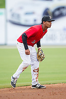 Kannapolis Intimidators shortstop Cleuluis Rondon (5) on defense against the Greenville Drive at CMC-Northeast Stadium on April 6, 2014 in Kannapolis, North Carolina.  The Intimidators defeated the Drive 8-5.  (Brian Westerholt/Four Seam Images)