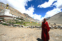 "China started building a controversial 67-mile ""paved highway fenced with undulating guardrails"" to Mount Qomolangma, known in the west as Mount Everest, to help facilitate next year's Olympic Games torch relay./// Monk Lobsang Cheodeng  stands in front of Rongbuk Monastery near Everest base camp."