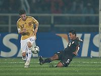 Bryan Duran (5) slide tackles Pablo Sarabia (17). Spain defeated the U.S. Under-17 Men National Team  2-1 at Sani Abacha Stadium in Kano, Nigeria on October 26, 2009.