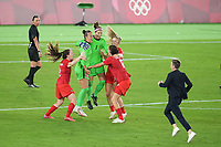 YOKOHAMA, JAPAN - AUGUST 6: Canada players including Stephanie Labbe #1 and Christine Sinclair #12 celebrate winning the gold medal during a game between Canada and Sweden at International Stadium Yokohama on August 6, 2021 in Yokohama, Japan.
