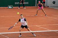 Paris, France, 2 june 2021, Tennis, French Open, Roland Garros, First round womans doubles match: Demi Schuurs (NED)  (L) and  Nicole Melichar (USA)<br /> Photo: tennisimages.com