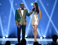 ATLANTA, GA - DECEMBER 8: 2019 MISS UNIVERSE: Host Steve Harvey and Miss Thailand, Paweensuda Drouin appears on the 2019 MISS UNIVERSE competition airing LIVE onSunday, Dec. 8(7:00-10:00 PM ET live/PT tape-delayed) on FOX. (Photo by Frank Micelotta/FOX/PictureGroup)