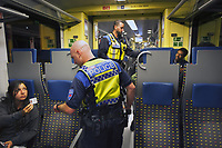 Switzerland. Canton Ticino. Two police officers from TPO (Transport Police) are controlling the train tickets' validity of passengers travelling late at night on a TILO train between Lugano and Mendrisio.TPO (Transport Police) is the Swiss Federal Railways Police. Swiss Federal Railways (German: Schweizerische Bundesbahnen (SBB), French: Chemins de fer fédéraux suisses (CFF), Italian: Ferrovie federali svizzere (FFS)) is the national railway company of Switzerland. It is usually referred to by the initials of its German, French and Italian names, as SBB CFF FFS. TILO (Treni Regionali Ticino Lombardia) creates efficient train connections between the towns in the canton Ticino.10.06.2017 © 2017 Didier Ruef