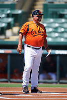 GCL Orioles manager Orlando Gomez (23) during the lineup exchange before a game against the GCL Twins on August 11, 2016 at the Ed Smith Stadium in Sarasota, Florida.  GCL Twins defeated GCL Orioles 4-3.  (Mike Janes/Four Seam Images)