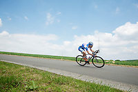 Tim De Troyer (BEL/Wanty-GroupeGobert) stearing into a highspeed corner with his teammates in tow<br /> <br /> 2014 Belgium Tour<br /> (final) stage 5: Oreye - Oreye (179km)