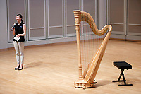 USA International Harp Competition Executive Director Erin Brooker-Miller makes an announcement before a laureate recital by harpist Katherine Siochi during the 11th USA International Harp Competition at Indiana University in Bloomington, Indiana on Friday, July 5, 2019. (Photo by James Brosher)
