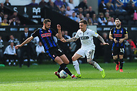 Clark Robertson of Rotherham United vies for possession with Barrie McKay of Swansea City during the Sky Bet Championship match between Swansea City and Rotherham United at the Liberty Stadium in Swansea, Wales, UK.  Friday 19 April 2019