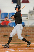 Kipp Schutz #15 of the Bluefield Orioles follows through on his swing versus the Johnson City Cardinals at Howard Johnson Field August 1, 2009 in Johnson City, Tennessee. (Photo by Brian Westerholt / Four Seam Images)